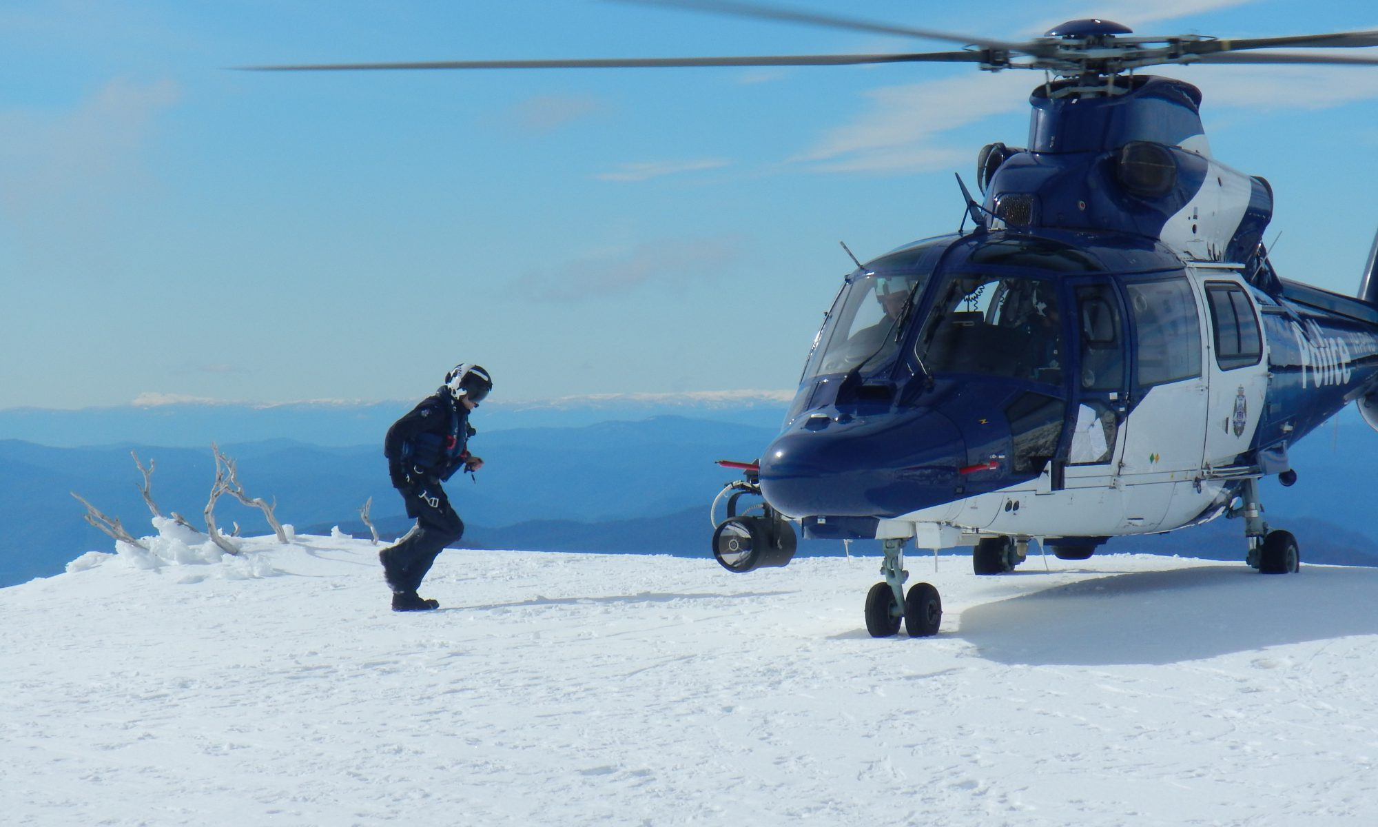 Victoria Police helicopter on Mt Bogong with crewman